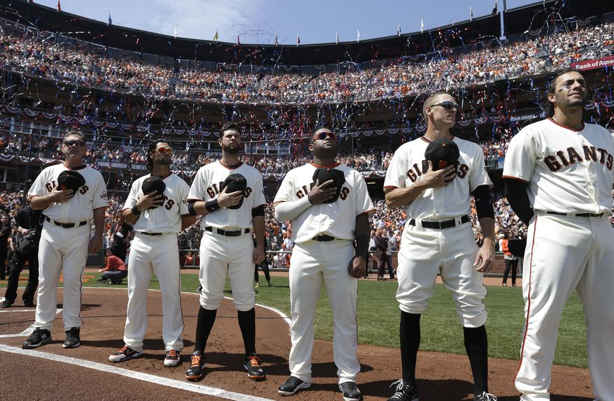 From left, San Francisco Giants manager Bruce Bochy, Angel Pagan, Brandon Belt, Pablo Sandoval, Hunter Pence, and Michael Morse stand during the national anthem before the home opener MLB National League baseball game against the Arizona Diamondbacks in San Francisco, Tuesday, April 8, 2014. (AP Photo/Eric Risberg, Pool)