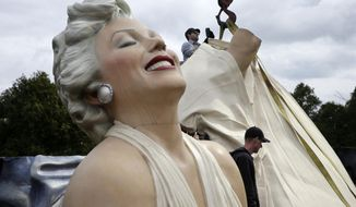 "Workers prepare to lift parts of a 26-foot-tall, 34,000-pound statue named ""Forever Marilyn"" in Hamilton, N.J., Tuesday, April 8, 2014. The sculpture depicting Marilyn Monroe in her memorable billowing skirt pose from the ""The Seven Year Itch"" is part of  an exhibit honoring its designer, Seward Johnson. (AP Photo/Mel Evans)"