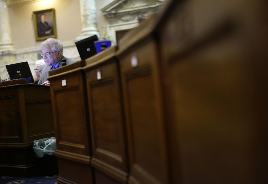 Rep. Samuel Rosenberg, D-Baltimore City, works at his desk in the House of Delegates chamber in Annapolis, Md., Monday, April 7, 2014, the final day of the 2014 legislative session. (AP Photo/Patrick Semansky)