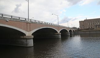 This photo taken on Monday, April 7, 2014, shows the Grand Avenue bridge in downtown Des Moines.  replacement of a downtown bridge matches the arched appearance of other nearby bridges.  (AP Photo/The Des Moines Register, Kelsey Kremer) MAGS OUT, TV OUT, NO SALES, MANDATORY CREDIT