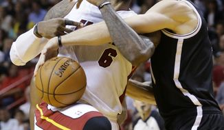 Miami Heat forward LeBron James (6) is fouled by Brooklyn Nets forward Mason Plumlee as he goes up for a shot during the first half of an NBA basketball game, Tuesday, April 8, 2014 in Miami. (AP Photo/Wilfredo Lee)