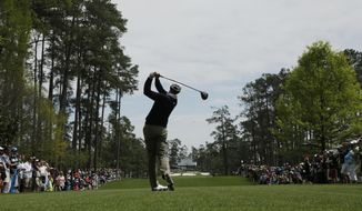 Adam Scott, of Australia, tees off on the seventh hole during a practice round for the Masters golf tournament Tuesday, April 8, 2014, in Augusta, Ga. (AP Photo/Charlie Riedel)
