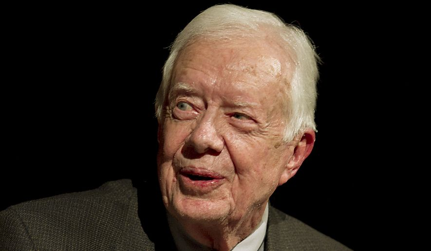 Former U.S. President Jimmy Carter speaks onstage with Mark Updegrove, director of the Lyndon B. Johnson Presidential Library in Austin, on the first day of the Civil Rights Summit, Tuesday, April 8, 2014, in Austin, Texas. (AP Photo/Statesman.com, Ralph Barrera, Pool)