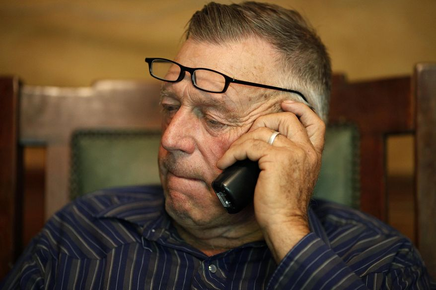 File-This Saturday, April 5, 2014 file photo shows Cliven Bundy talks on the phone at his ranch near Bunkerville Nev. Dave Bundy the son of Cliven Bundy a rural Nevada cattle rancher fighting government efforts to remove his cattle from disputed grazing areas northeast of Las Vegas was detained by federal agents. (AP Photo/Las Vegas Review-Journal, John Locher,File)