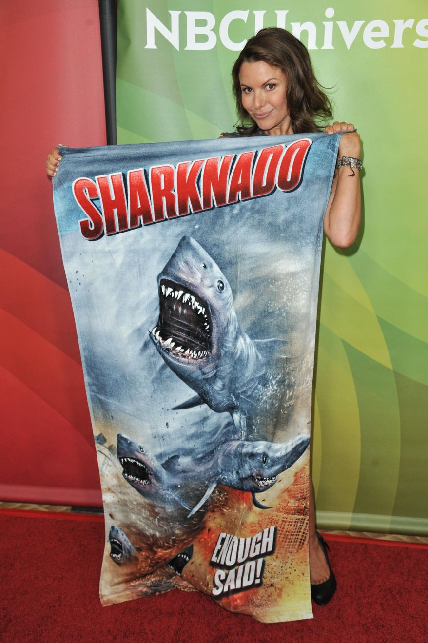 """Kari Wuhrer from the cast of """"Sharknado 2: The Second One"""" arrives at the NBC Universal Summer Press Day on Tuesday, April 8, 2014, in Pasadena, Calif. (Photo by Richard Shotwell/Invision/AP)"""