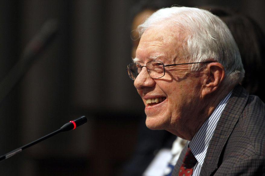 ** FILE ** In this June 28, 2013, file photo, former U.S. President Jimmy Carter speaks in Atlanta. (AP Photo/Jaime Henry-White, File)