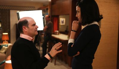 "In this photo released by AMC, creator Matthew Weiner, left, talks with actress Jessica Pare on the set of the TV series, ""Mad Men."" Weiner, as the auteur of the landmark drama series, voices both resolve and wonderment at his task of bringing ""Mad Men"" in for a landing. His goal, he says, is not to wallop the audience with a grand parting shot, but something more gently profound: ""to leave the characters in a place where they're going to be in viewers' imaginations forever."" The final season of ""Mad Men"" begins Sunday, April 13, 2014, at 10 p.m. EDT on AMC. (AP Photo/AMC, Jamie Trueblood)"