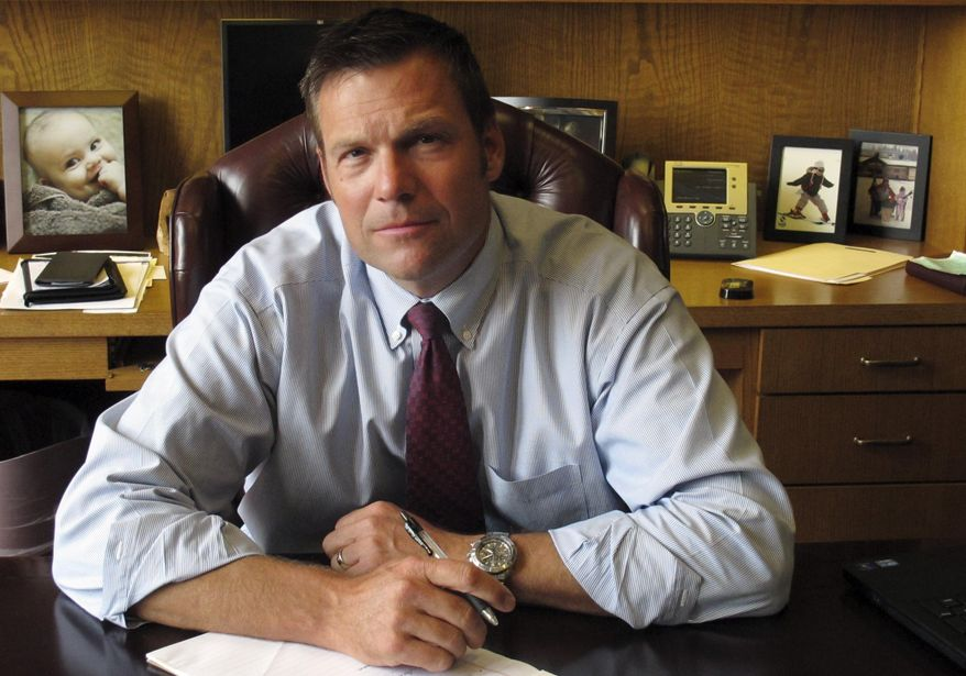 In this photo taken on Thursday, Aug. 1, 2013, Kansas Secretary of State Kris Kobach, the architect of the state's proof-of-citizenship law for new voters, answers questions during an Associated Press interview in Topeka, Kan. A federal judge agreed Tuesday, April 8, 2014, with the American Civil Liberties Union that a state court should decide a lawsuit challenging Kansas Secretary of State Kris Kobach's enforcement of the state's voter-citizenship rule. (AP Photo/John Hanna)