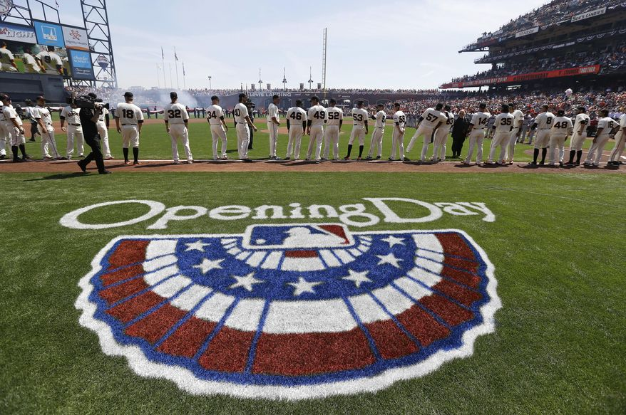 San Francisco Giants players stand during the national anthem before an opening day baseball game against the Arizona Diamondbacks in San Francisco, Tuesday, April 8, 2014. (AP Photo/Eric Risberg, Pool)