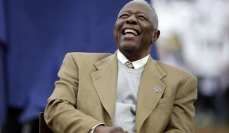 Hank Aaron laughs during a ceremony celebrating the 40th anniversary of his 715th home run before the start of a baseball game between the Atlanta Braves and the New York Mets, Tuesday, April 8, 2014, in Atlanta. (AP Photo/David Goldman)