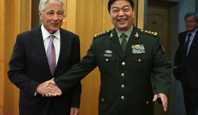 Defense Secretary Chuck Hagel shakes hands with Chinese Minister of Defense Chang Wanquan prior to their meeting at the Chinese Defense Ministry headquarters in Beijing, Tuesday, April 8, 2014. (AP Photo/Alex Wong, Pool)