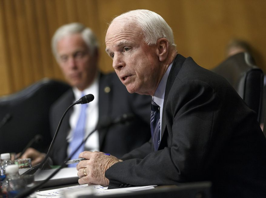 Senate Foreign Relations Committee member Sen. John McCain, R-Ariz., heaps criticism on the Obama administration's policies with Russia, Iran and other international hot spots as he questions Secretary of State Kerry during the committee's hearing, on Capitol Hill in Washington, Tuesday, April 8, 2014.  (AP Photo/J. Scott Applewhite)