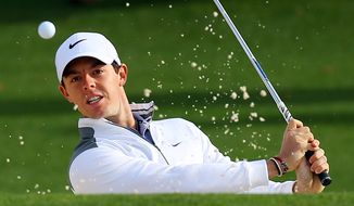 Rory McIlroy, of Northern Ireland, hits from the sand trap to the second green during practice for the Masters golf tournament Tuesday, April 8, 2014 in Augusta, Ga.  (AP Photo/Atlanta Journal-Constitution, Curtis Compton)  MARIETTA DAILY OUT; GWINNETT DAILY POST OUT; LOCAL TV OUT; WXIA-TV OUT; WGCL-TV OUT
