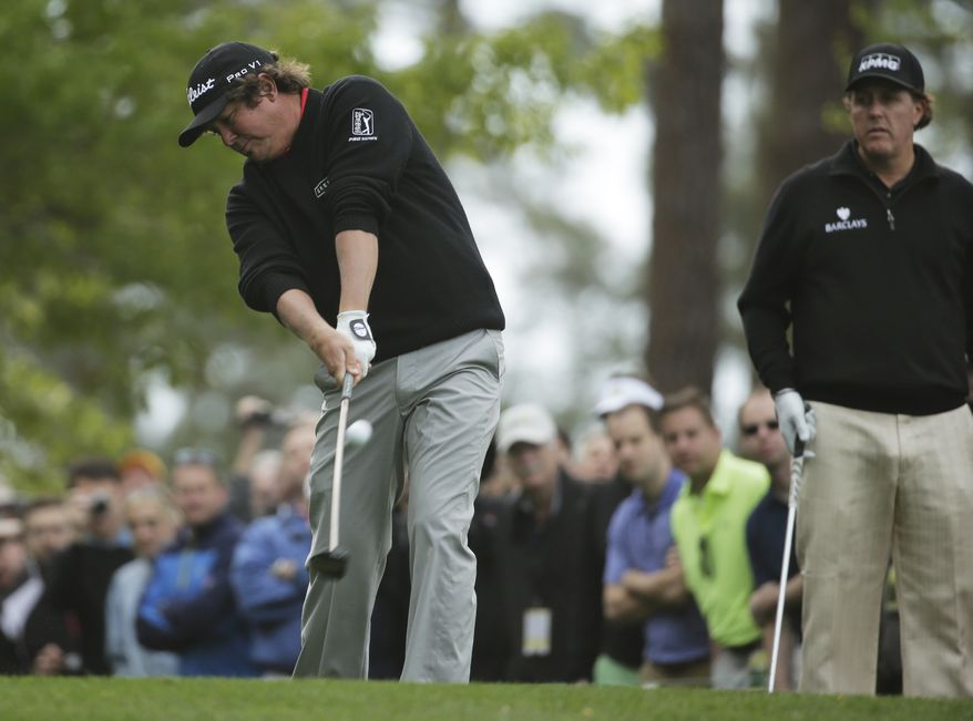 Jason Dufner tees off on the fourth hole during a practice round for the Masters golf tournament Tuesday, April 8, 2014, in Augusta, Ga. (AP Photo/Chris Carlson)