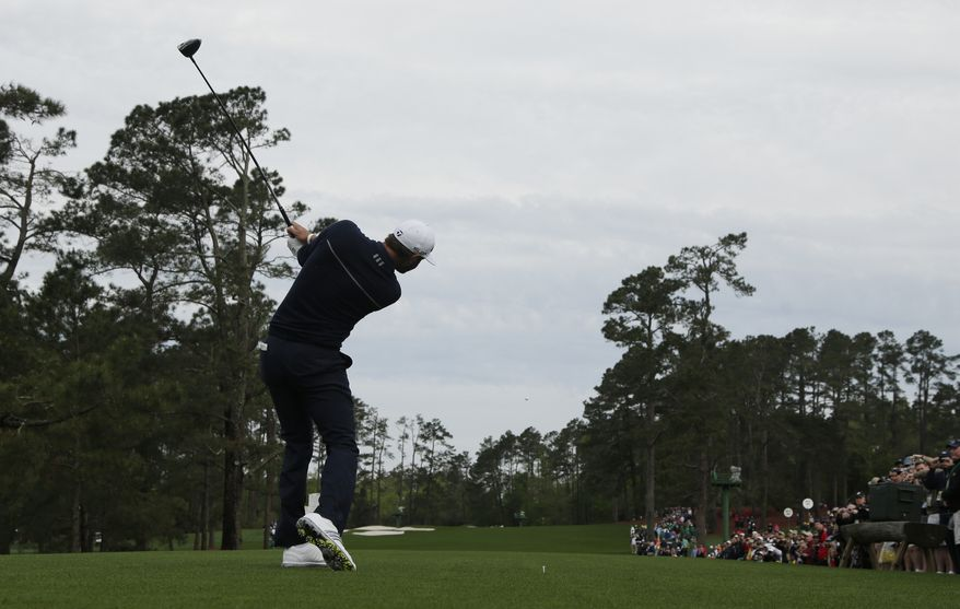Rickie Fowler tees off on the third hole during a practice round for the Masters golf tournament Tuesday, April 8, 2014, in Augusta, Ga. (AP Photo/Charlie Riedel)