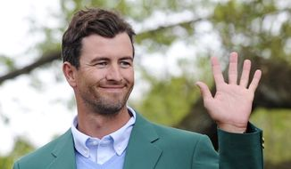 "The 2013 Masters champion Adam Scott, of Australia, waves to a crowd during a trophy presentation for the ""Drive, Chip and Putt"" contest at Augusta National on Sunday, April 6, 2014, in Augusta, Ga. (AP Photo/The Augusta Chronicle, Rainier Ehrhardt)"