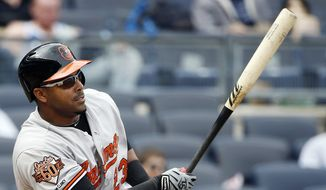 Baltimore Orioles Nelson Cruz watches his eighth-inning double in a baseball game against the New York Yankees at Yankee Stadium in New York, Tuesday, April 8, 2014. The Orioles won 14-5. (AP Photo/Kathy Willens)