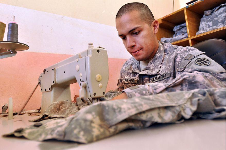 Uniform repair in Iraq. (U.S. Army photo)