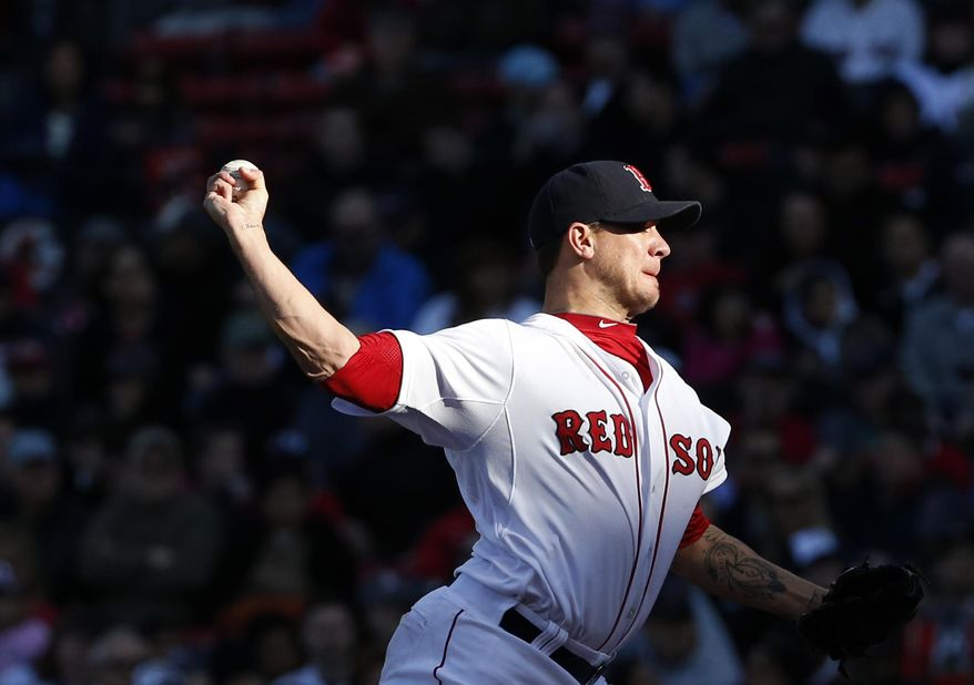 Boston Red Sox starting pitcher Jake Peavy delivers to the Texas Rangers in the third inning of a baseball game at Fenway Park in Boston, Wednesday, April 9, 2014. (AP Photo/Elise Amendola)