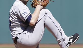 San Diego Padres starting pitcher Eric Stults delivers in the first inning in the first baseball game of a doubleheader against the Cleveland Indians, Wednesday, April 9, 2014, in Cleveland. (AP Photo/Tony Dejak)