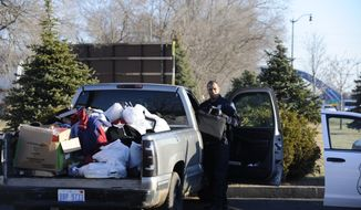 Police search a pickup truck outside the Comfort Inn on South Telegraph in Taylor, Mich, Wednesday, April 9, 2014. Police canceled an Amber Alert for an 8-year-old girl Wednesday morning after she was discovered at the home her family had just vacated a day earlier. (AP Photo/Detroit News, David Coates)  DETROIT FREE PRESS OUT; HUFFINGTON POST OUT