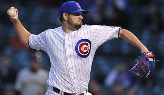 Chicago Cubs starter Jason Hammel delivers a pitch during the first inning of a baseball game against the Pittsburgh Pirates in Chicago, Wednesday, April 9, 2014. (AP Photo/Paul Beaty)