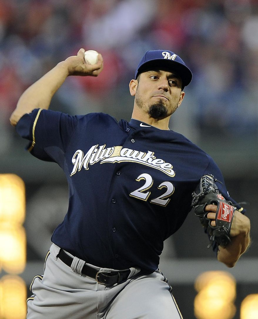 Milwaukee Brewers starting pitcher Matt Garza delivers during the first inning of a baseball game against the Philadelphia Phillies, Wednesday, April 9, 2014, in Philadelphia. (AP Photo/Michael Perez)