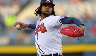 Atlanta Braves starting pitcher Ervin Santana delivers during the first inning of the baseball game against the New York Mets, Wednesday, April 9, 2014, in Atlanta. (AP Photo/Todd Kirkland)