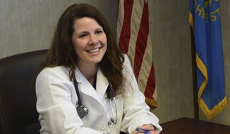 This Feb. 17, 2014, photo shows Sioux Falls physician Annette Bosworth talking about her candidacy for the U.S. Senate seat being vacated by Sen. Tim Johnson in Sioux Falls, S.D. Bosworth will face four opponents in the Republican primary on June 3. (AP Photo/Dirk Lammers)
