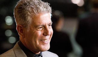 "FILE - In this Oct. 11, 2012 file photo, Anthony Bourdain attends ""On The Chopping Block: A Roast of Anthony Bourdain"" in New York. Bourdain's ""Parts Unknown"" series, a culinary travelogue, swiftly became CNN's top-rated series since debuting last April, a bright spot at a place that was in a severe dry spell before the missing Malaysian plane kicked up ratings. A new eight-episode season begins Sunday, April 13, 2014, at 9 p.m. EDT. (Photo by Charles Sykes/Invision/AP Images, File)"