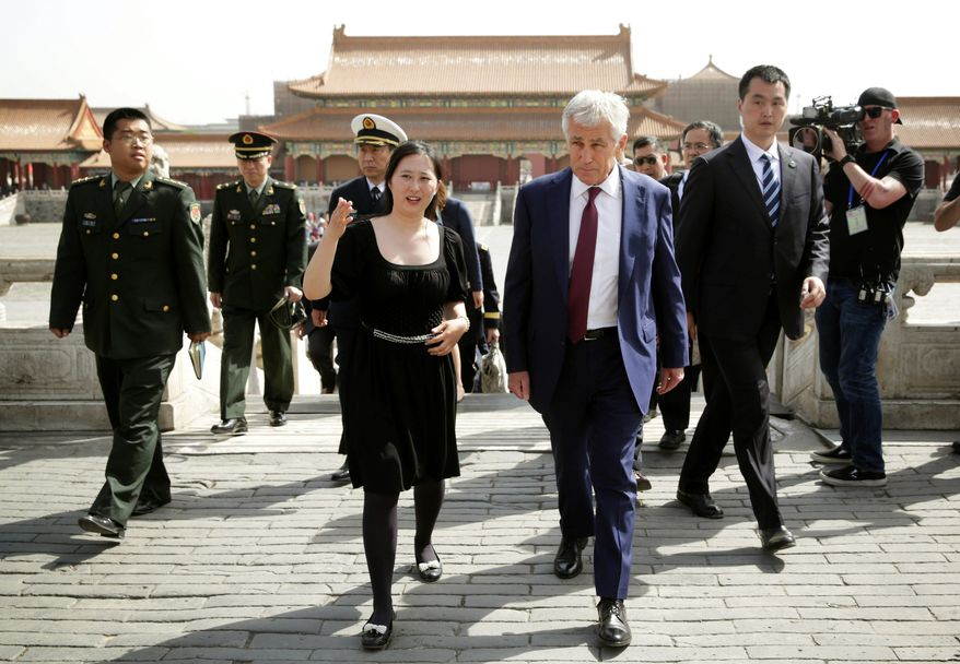 Defense Secretary Chuck Hagel announced that he authorized releasing details of the U.S. cyber warfare doctrine to China in a bid to win cooperation from Beijing. (Associated Press)