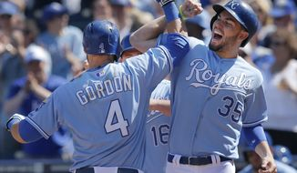 Kansas City Royals' Alex Gordon (4) is congratulated by teammate Eric Hosmer (35) after his three-run home run during the fifth inning of a baseball game against the Tampa Bay Rays at Kauffman Stadium in Kansas City, Mo., Wednesday, April 9, 2014. (AP Photo/Orlin Wagner)