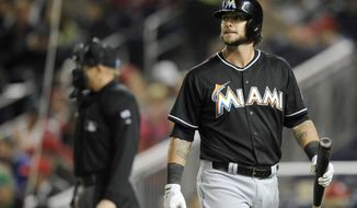 Miami Marlins' Jarrod Saltalamacchia looks on after he struck out during the fourth inning of a baseball game against the Washington Nationals, Tuesday, April 8, 2014, in Washington. The Nationals won 5-0. (AP Photo/Nick Wass)