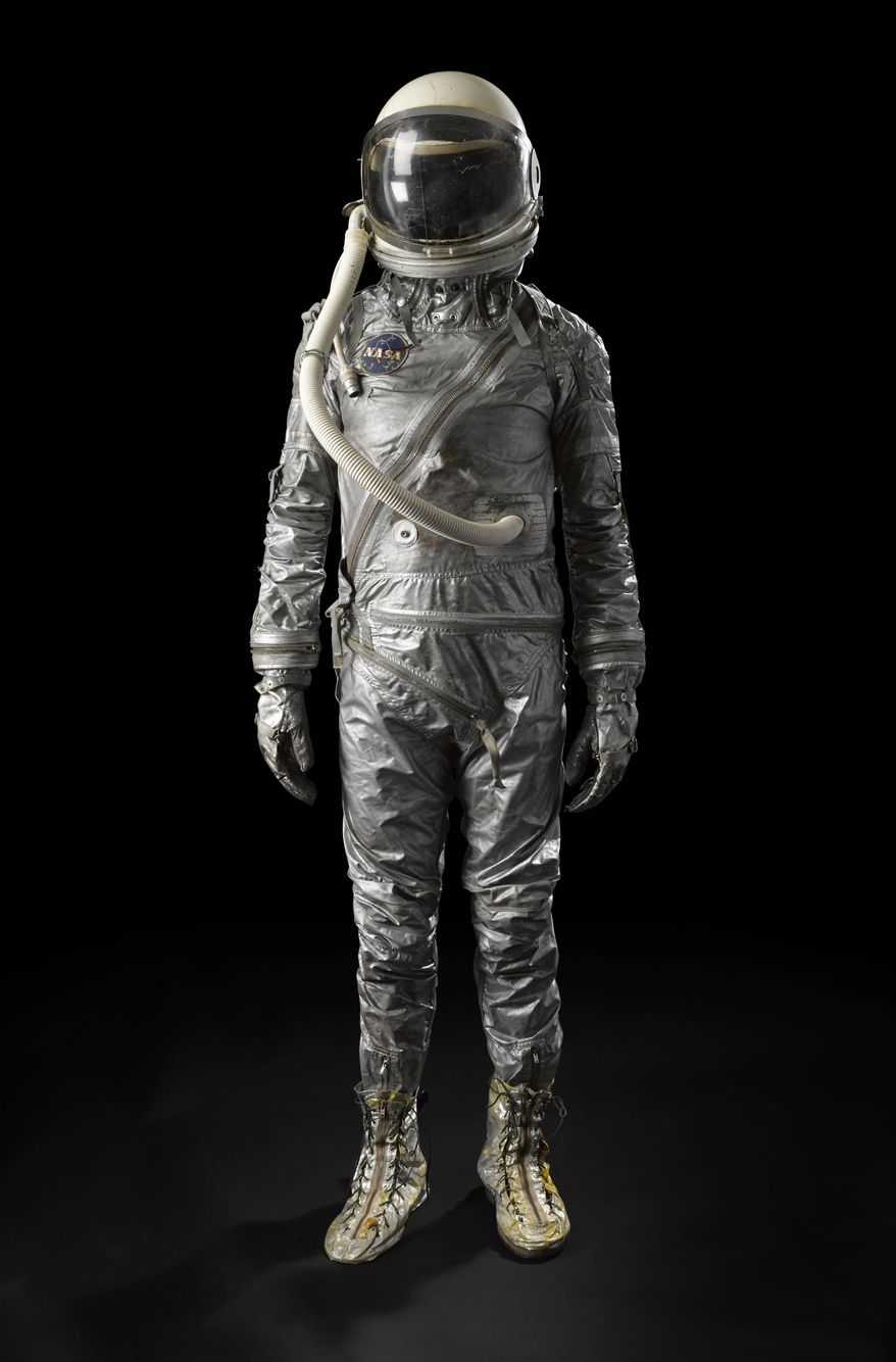 This undated photo provided by Bonhams auction house on April 4, 2014 shows a space suit from NASA's Mercury era. The suit was never worn by an astronaut on an actual space mission but will be among the artifacts of space history that will be offered at auction by Bonhams in New York on Tuesday, April 8, 2014. (AP Photo/Bonhams)