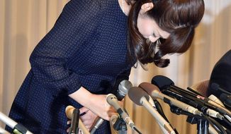 Haruko Obokata, a researcher of Japanese government-funded laboratory Riken Center for Development Biology, bows in apology at the beginning of a press conference at a hotel in Osaka, western Japan Wednesday, April 9, 2014. The scientist accused of falsifying data in a widely heralded stem-cell research paper said that despite mistakes in her work the results are valid. (AP Photo/Kyodo News) JAPAN OUT, MANDATORY CREDIT