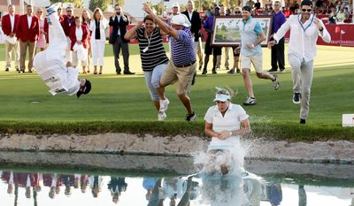 10ThingstoSeeSports - Lexi Thompson jumps into Poppy's Pond after winning the Kraft Nabisco Championship golf tournament Sunday, April 6, 2014, in Rancho Mirage, Calif. (AP Photo/Chris Carlson, File)