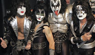 ** FILE ** In this May 8, 2008, file photo, members of Kiss, from left, Paul Stanley, Eric Singer, Gene Simmons and Tommy Thayer, poses for a photograph during a news conference to promote the start of their KISS Alive/35 European Tour in Oberhausen, Germany. (AP Photo/Volker Wiciok, file)