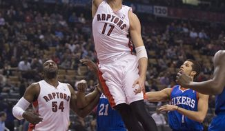 Toronto Raptors center Jonas Valanciunas (17) goes to the net for the first two points of the game during first half NBA action against the Philadelphia 76ers in Toronto on Wednesday, April 9, 2014.  (AP Photo/The Canadian Press, Peter Power)