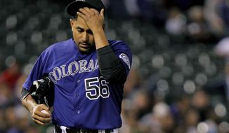 Colorado Rockies starting pitcher Franklin Morales (56) shows emotion during the fifth inning of a baseball gameagainst the Chicago White Sox, Tuesday, April 8, 2014, in Denver. (AP Photo/Barry Gutierrez)