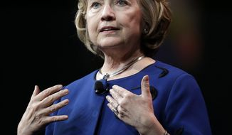 ** FILE ** This April 8, 2014, file photo shows former Secretary of State Hillary Rodham Clinton  speaking in San Francisco. (AP Photo/Ben Margot, File)