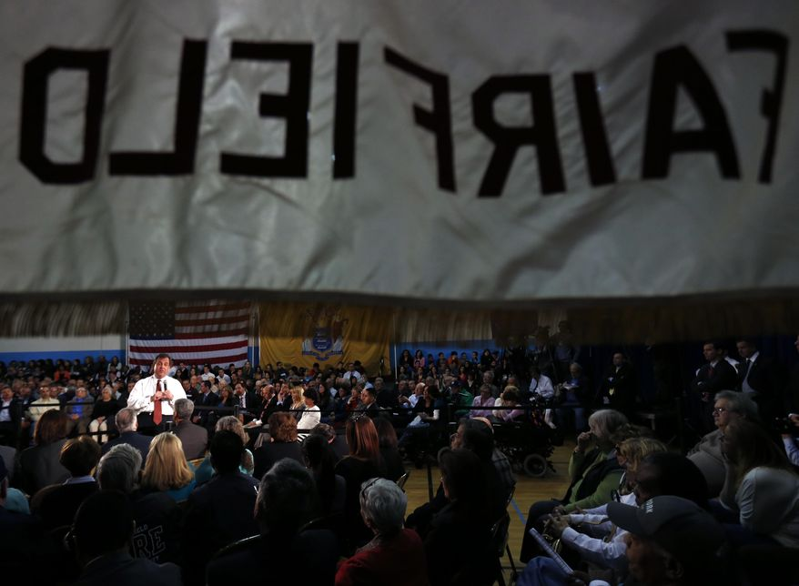 New Jersey Gov. Chris Christie talks during a town hall meeting at Winston Churchill Elementary School, Wednesday, April 9, 2014, in Fairfield, N.J. (AP Photo/Julio Cortez)