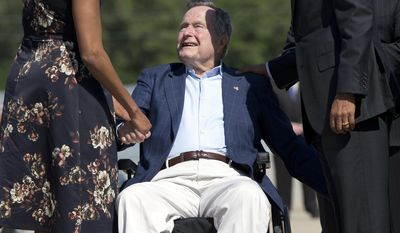 President Barack Obama and first lady Michelle Obama are greeted by former President George H.W. Bush as they arrive on Air Force One at George Bush Intercontinental Airport, Wednesday, April 9, 2014, in Houston. (AP Photo/Carolyn Kaster)