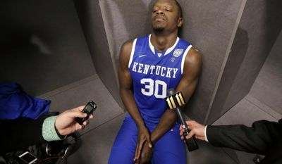 10ThingstoSeeSports - Kentucky forward Julius Randle is interviewed in the locker room after his team's 60-54 loss to Connecticut in the NCAA Final Four tournament college basketball championship game Monday, April 7, 2014, in Arlington, Texas. (AP Photo/Eric Gay, File)