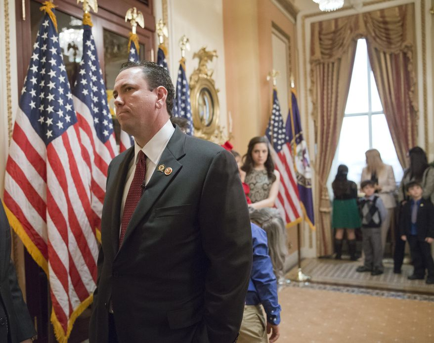 """This photo taken Nov. 21, 2013 shows then-newly-elected Rep. Vance McAllister, R-La. waiting to be sworn in on Capitol Hill in Washington. McAllister says he's asking his family and constituents for forgiveness after a West Monroe newspaper published a video that it says shows the congressman kissing a female staffer in his congressional office in Monroe, La. McAllister, only in office a little over four months, attracted national attention because of his endorsement from the bearded men of the """"Duck Dynasty"""" reality TV show. (AP Photo/J. Scott Applewhite)"""