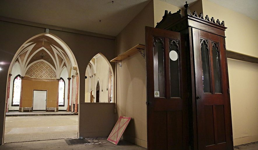 This March 19, 2014 file photo shows the confessional box inside a dilapidated Catholic parish. (AP Photo/The Herald-News, Rob Winner)  MANDATORY CREDIT **FILE**