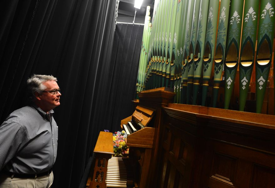 In this photo taken on April 2, 2014,  Guy McClure looks at the beautiful pipe organ, made in 1892, which was part of the renovation of the historic McCandless Hall at Athens State University in Athens, Ala.  The organ is rare with only between 500 and 1,000 remaining in use.  The organ restoration cost $100,000 and was part of a $4 million restoration of McCandless Hall.  (AP Photo/The Decatur Daily, Gary Cosby Jr.)