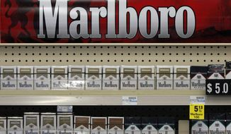 FILE - In this Wednesday, July 17, 2013 file photo, Marlboro cigarettes are on display in a CVS store in Pittsburgh. Major retailers will be paying close attention to the sales numbers after CVS Caremark pulls tobacco from its shelves by October. If the old retail rules governing tobacco have not changed outright, they are at least coming up for review. (AP Photo/Gene J. Puskar, File)