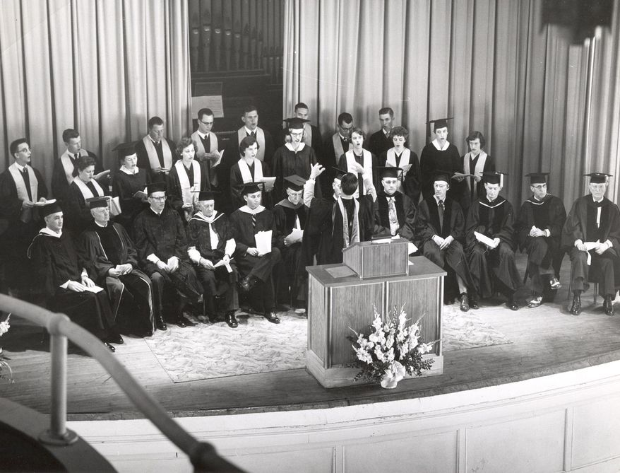 In this 1950's photo released by Athens State University, a group performs at McCandless Hall at Athens State University in Athens, Ala.  A portion of the vintage 1892 pipe organ is seen on stage behind the curtain.  The Hall and the organ have recently been renovated.  The tracker style pipe organ is rare and is one of only between 500 and 1,000 still in use.  (AP Photo/Athens State University via The Decatur Daily)