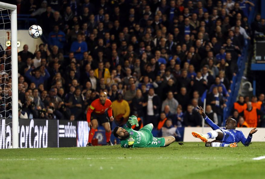 10ThingstoSeeSports - Chelsea's Demba Ba scores his side's 2nd goal during the Champions League second leg quarterfinal soccer match between Chelsea and Paris Saint-Germain at Stamford Bridge Stadium in London, Tuesday, April 8, 2014. (AP Photo/Kirsty Wigglesworth, File)
