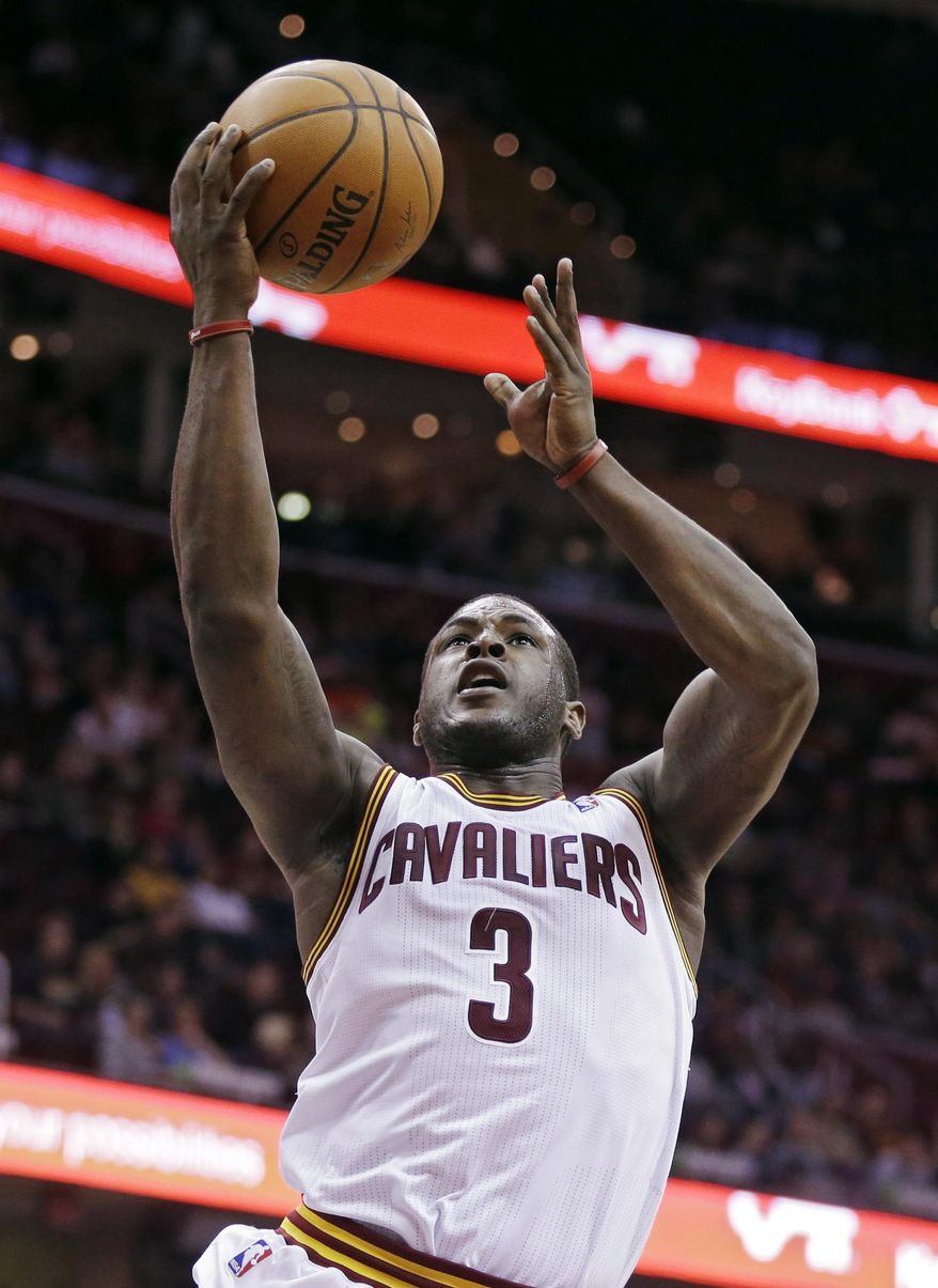 Cleveland Cavaliers' Dion Waiters goes up for a shot against the Detroit Pistons in the fourth quarter of an NBA basketball game Wednesday, April 9, 2014, in Cleveland. Waiters led the Cavaliers with 22 points in their 122-100 win. (AP Photo/Mark Duncan)